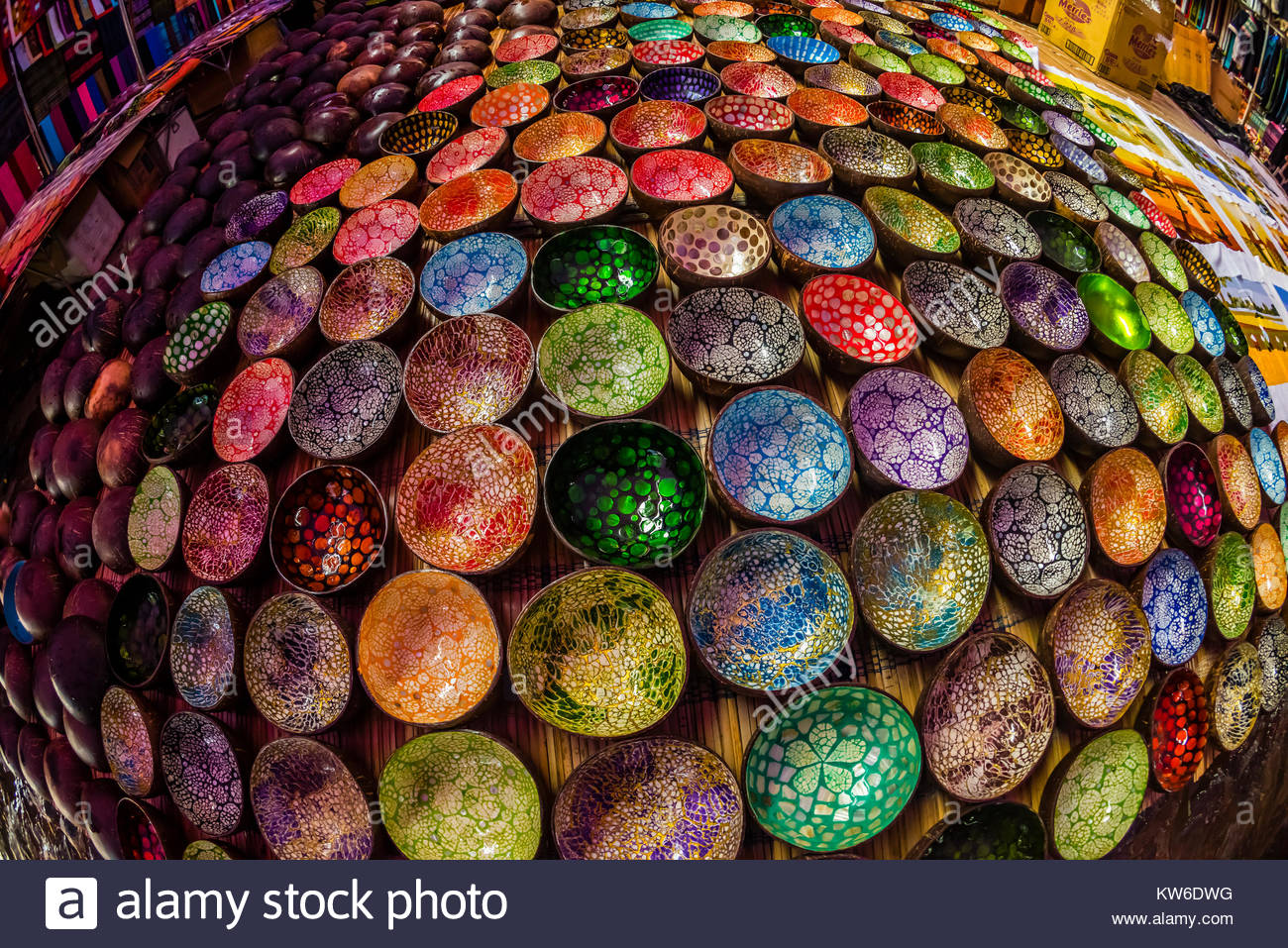 Colorful Vietnamese lacquer coconut shell bowls,  Sunday market at Ba Ha, northern Vietnam. Every Sunday ethnic - Stock Image