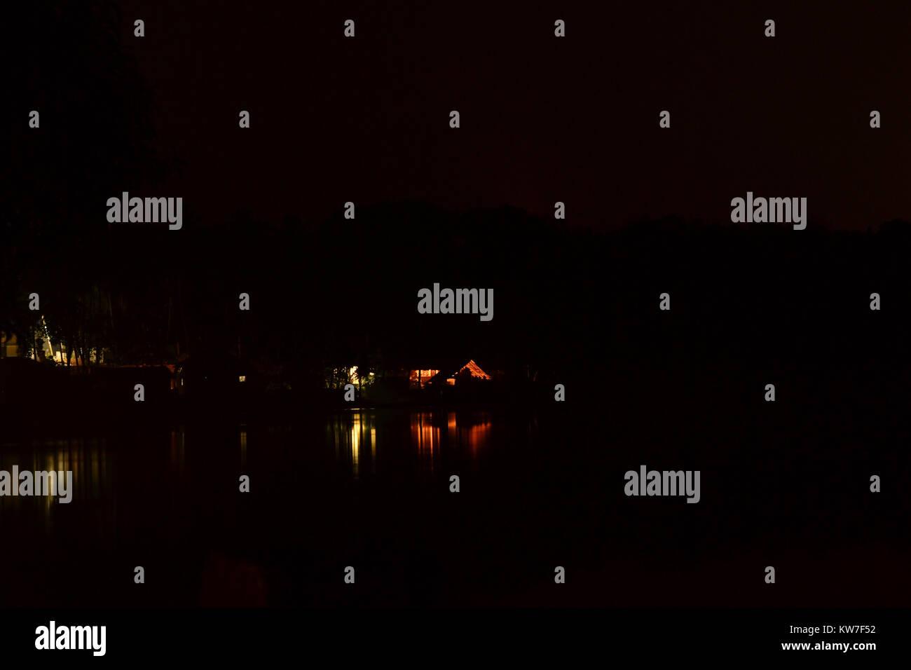 Reflections of Night at Vellayani Lake, Kerala - Stock Image