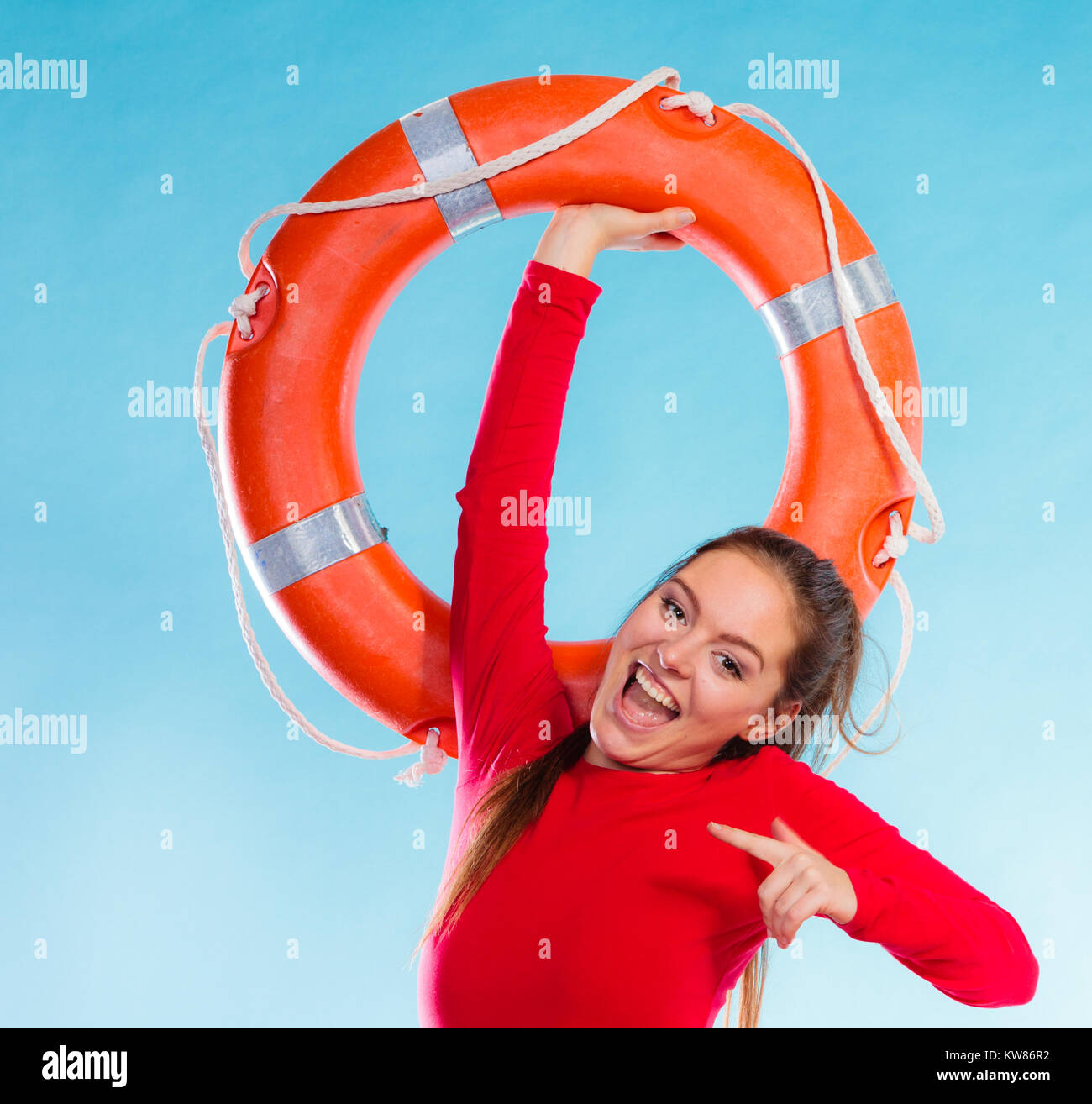 c04f89c1192 Accident prevention and water rescue. Young woman female smiling lifeguard  on duty holding lifesaver equipment having fun on blue