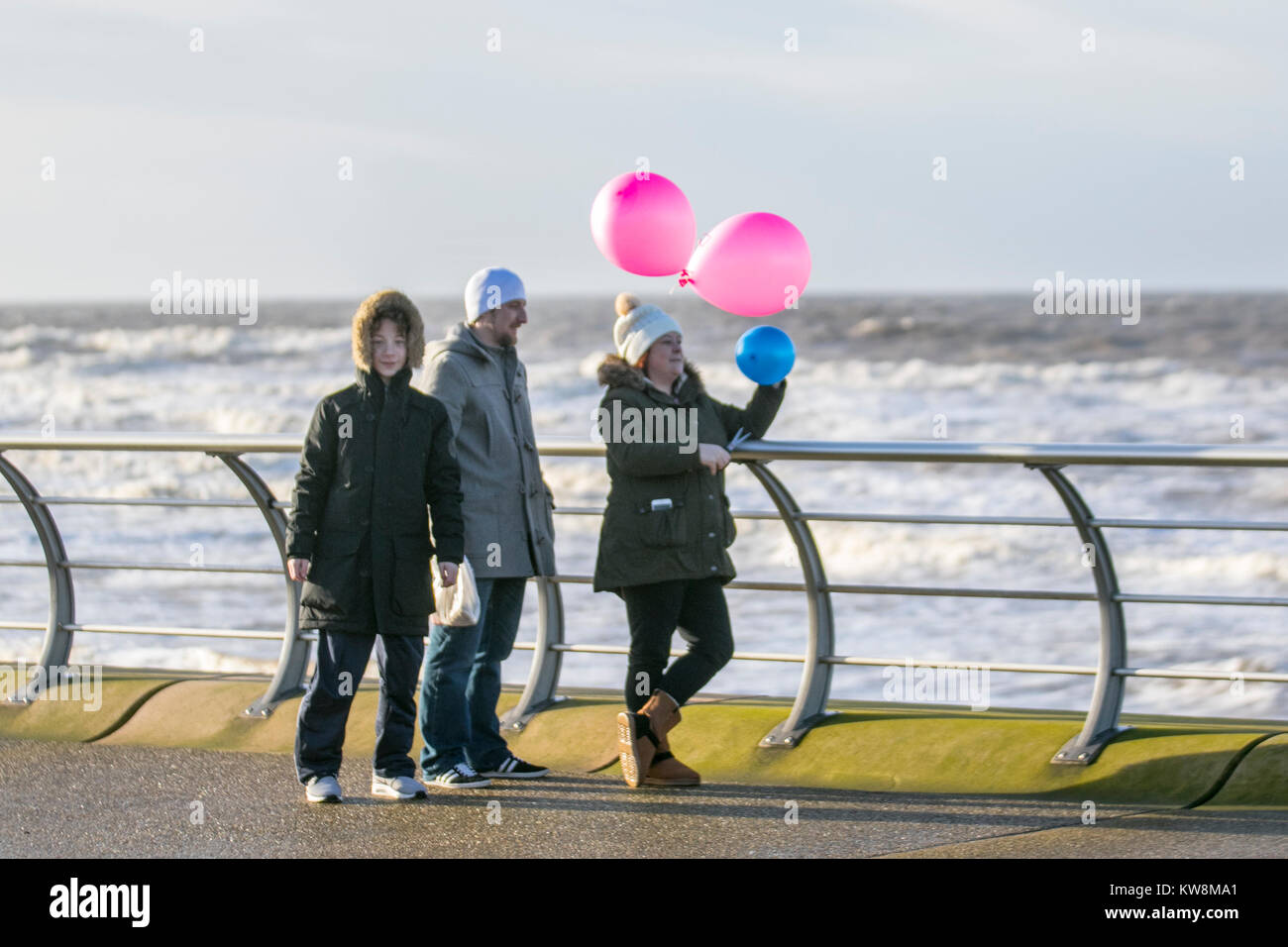 Blackpool, Lancashire. UK Weather. 31st December, 2017. Weather warnings for Storm Dylan , as Chinese tourists enjoy - Stock Image