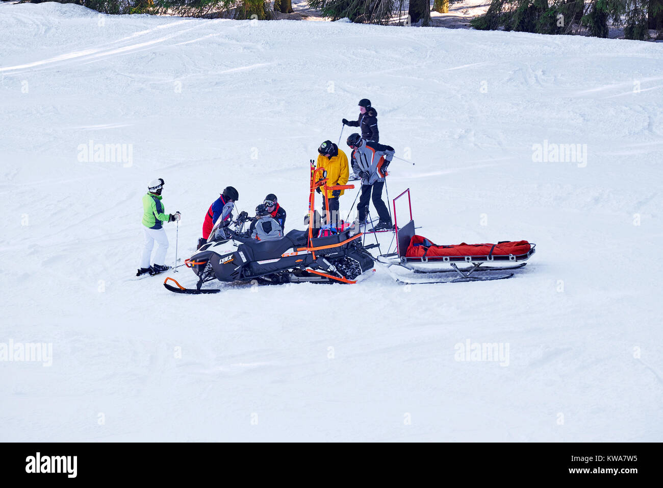 WINTERBERG, GERMANY - FEBRUARY 15, 2017: Rescue snowmobile at an injured skier on a ski slope - Stock Image
