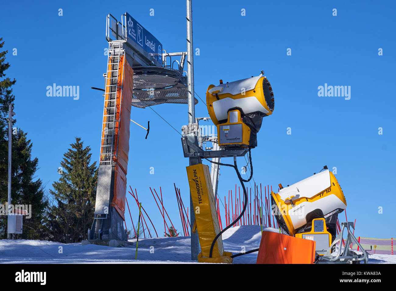 WINTERBERG, GERMANY - FEBRUARY 15, 2017: Ski cannons standing on a top in front of a draw lift  in Ski Carousel - Stock Image