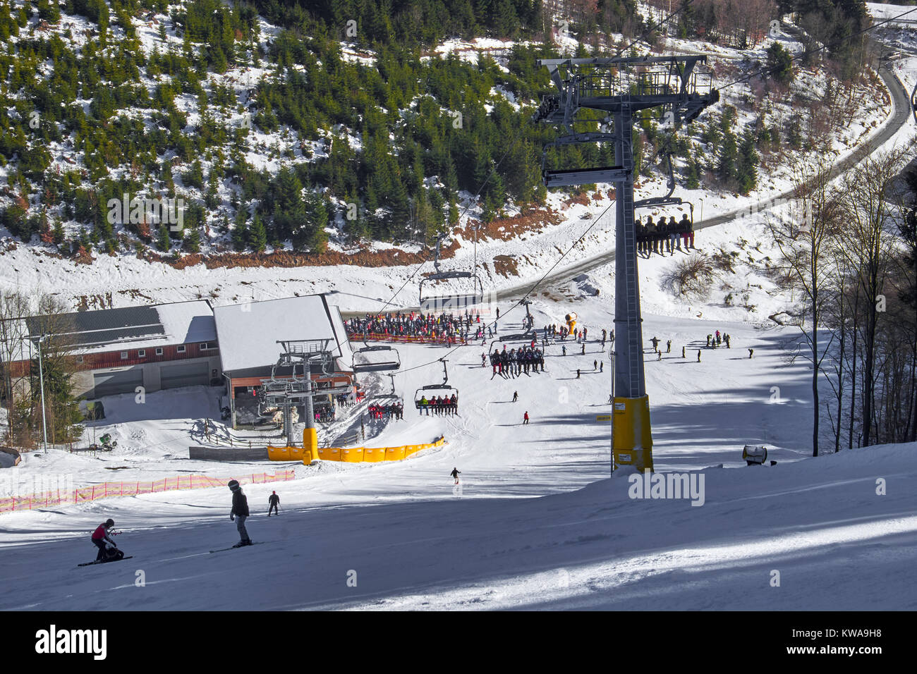 WINTERBERG, GERMANY - FEBRUARY 14, 2017: Typical piste with chairlift and people doing slalom at Ski Carousel Winterberg - Stock Image