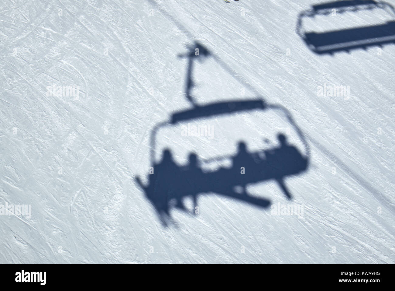 Shadow of a chairlift gliding over the snow on the ground at Ski Carousel Winterberg - Stock Image