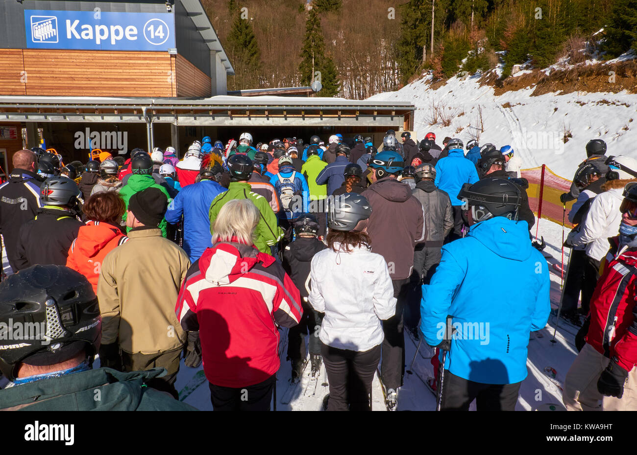 WINTERBERG, GERMANY - FEBRUARY 14, 2017: Skiers standing waiting in line to get to a chairlift for getting to the - Stock Image