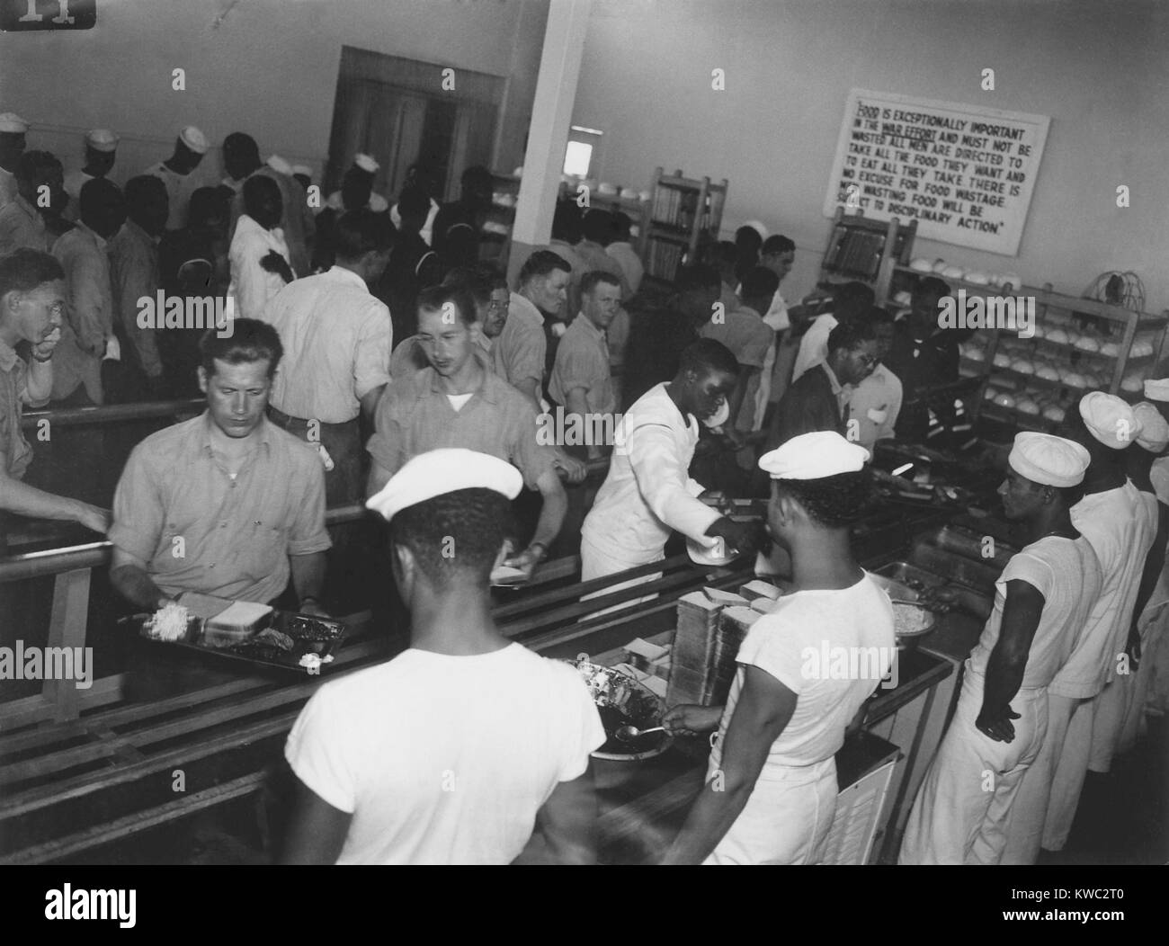 African America enlisted men in Mess Hall serving whites first at Hastings, Nebraska, 1944. In June 1944, racial - Stock Image