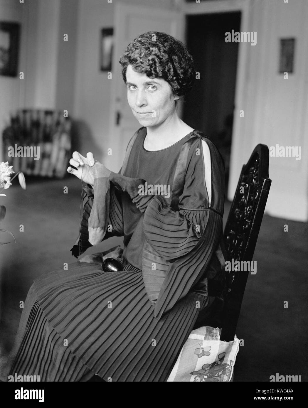 First Lady Grace Coolidge darning socks on August 6, 1923. It was four days after the death of President Warren - Stock Image