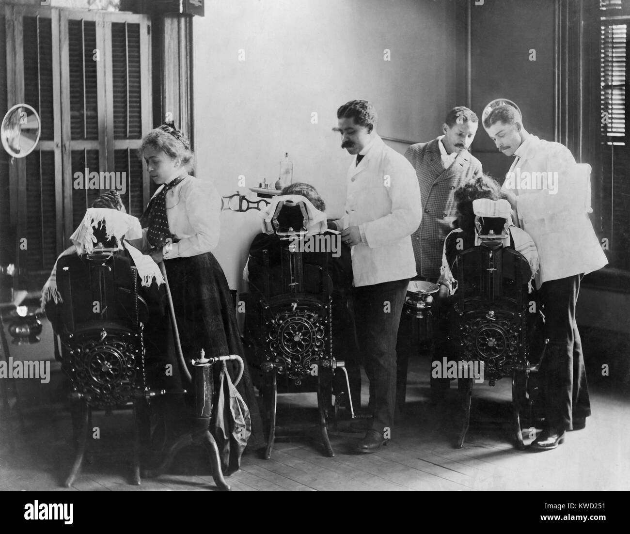 African American dentistry students practicing at Howard University, 1900. Howard was chartered by Congress in 1867 - Stock Image
