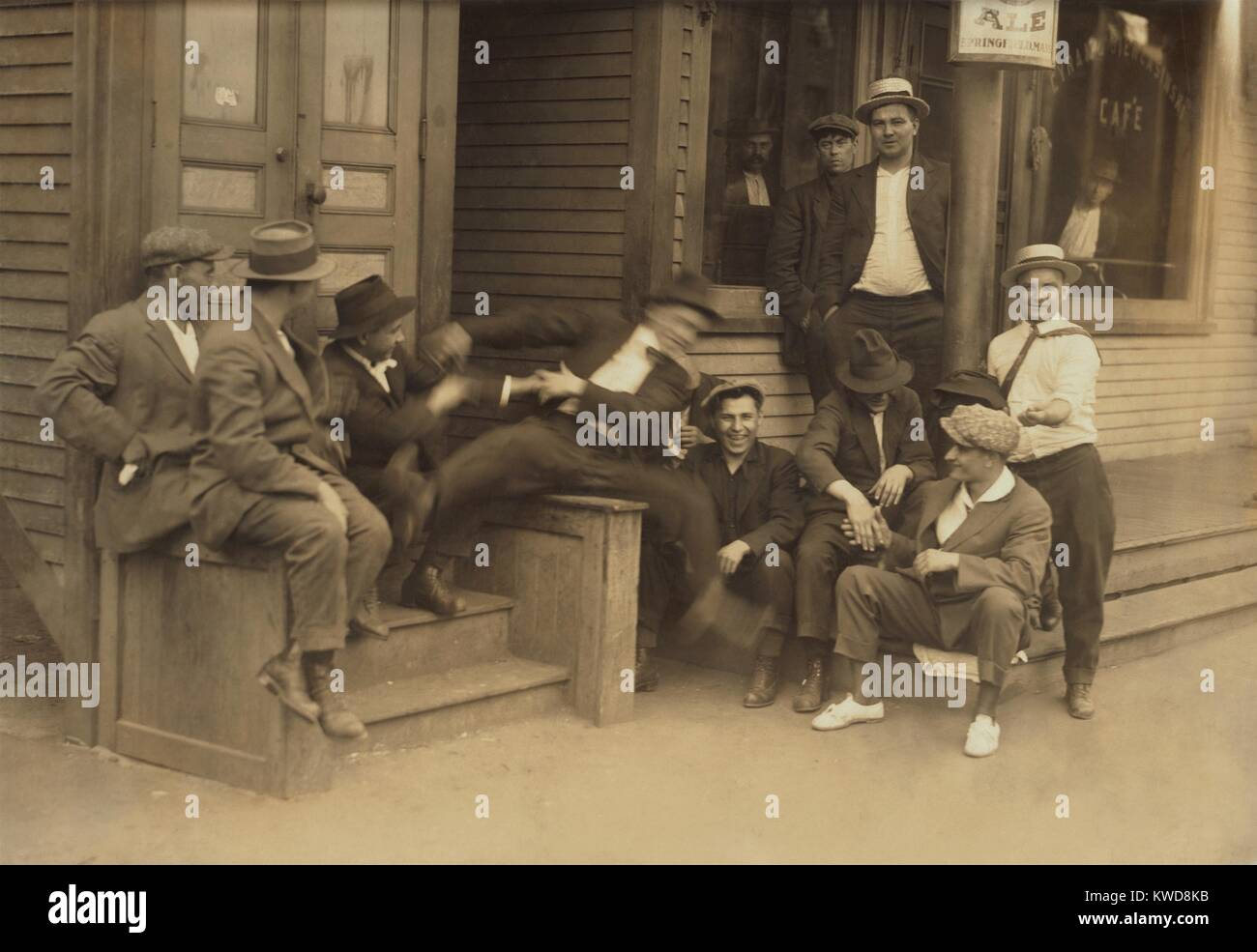 Young men hanging around a saloon in Chicopee Falls, Massachusetts, June 29, 1916. They are in good cheer, including - Stock Image