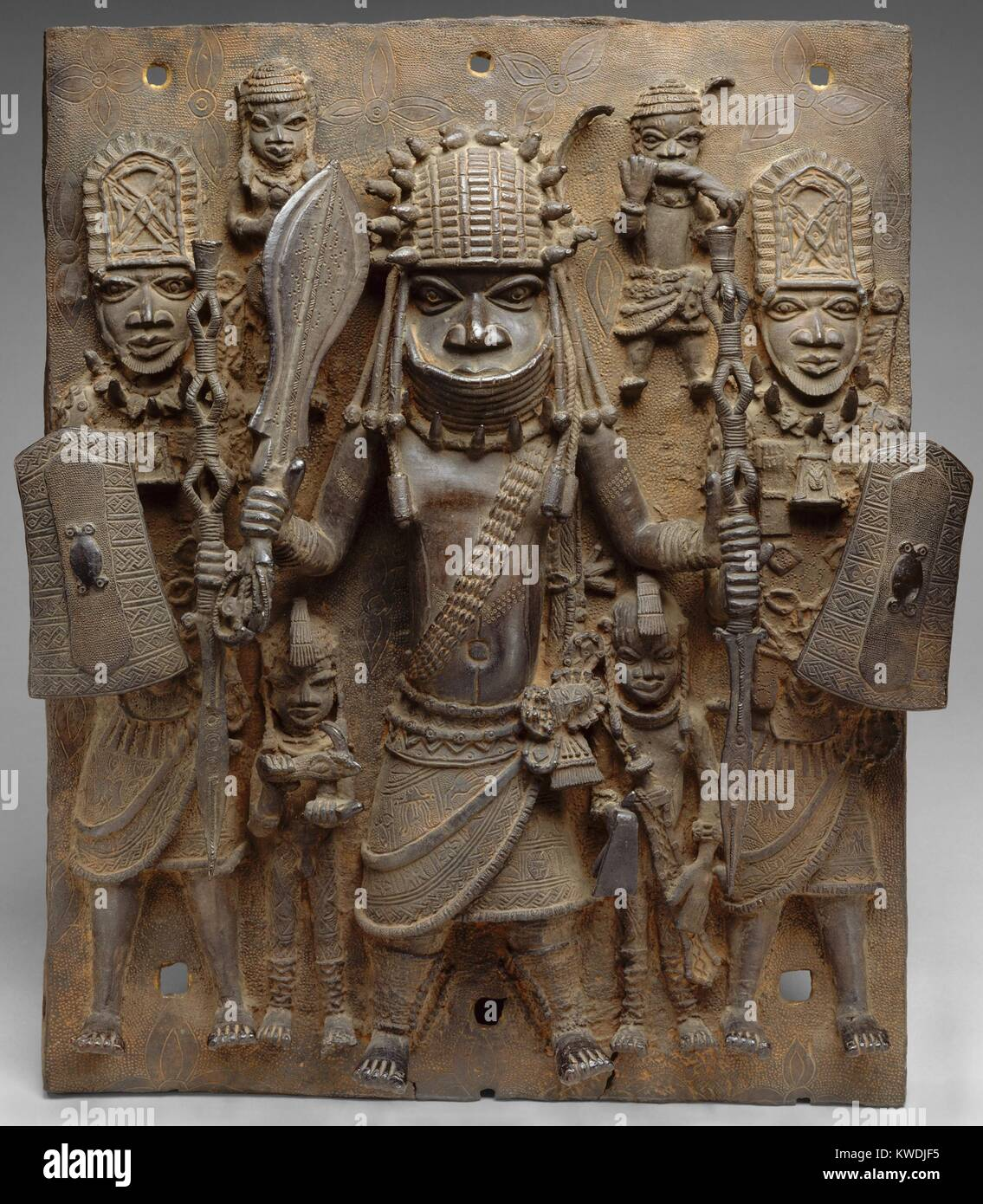 PLAQUE WARRIOR AND ATTENDANTS, 16th-17th c., Nigeria, Africa, Court of Benin, sculpture, cast brass. This work hung - Stock Image