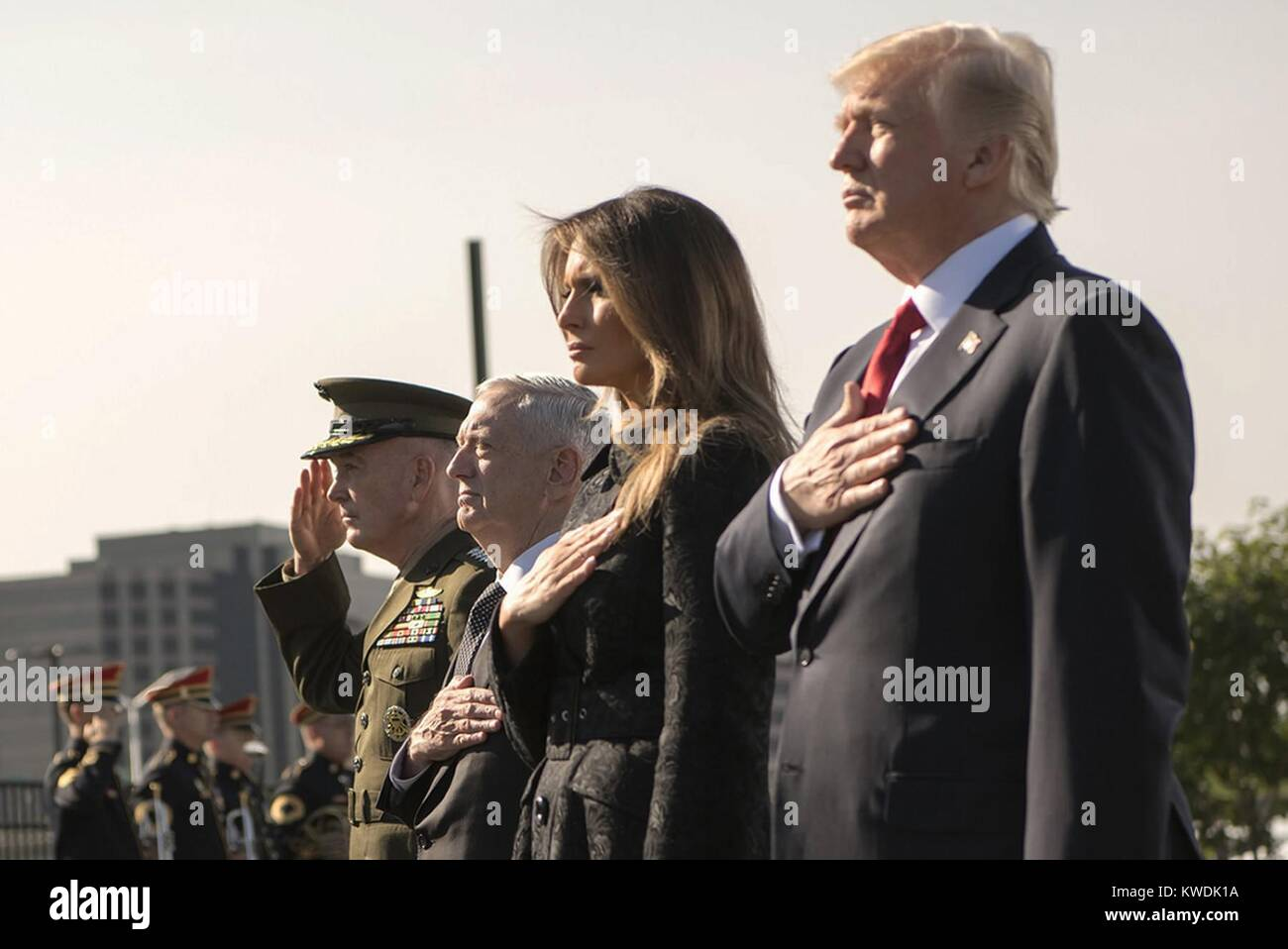 President Trump during the 9/11 Observance Ceremony at the Pentagon, Sept. 11, 2017. Standing in salute, R-L: President - Stock Image