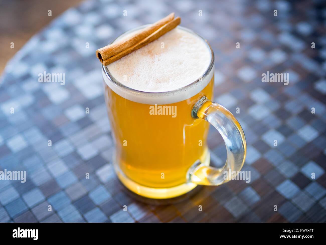 A mug of hot apple cider with cinnamon stick at D'Lish by Tish Cafe in Saskatoon, Saskatchewan, Canada. - Stock Image