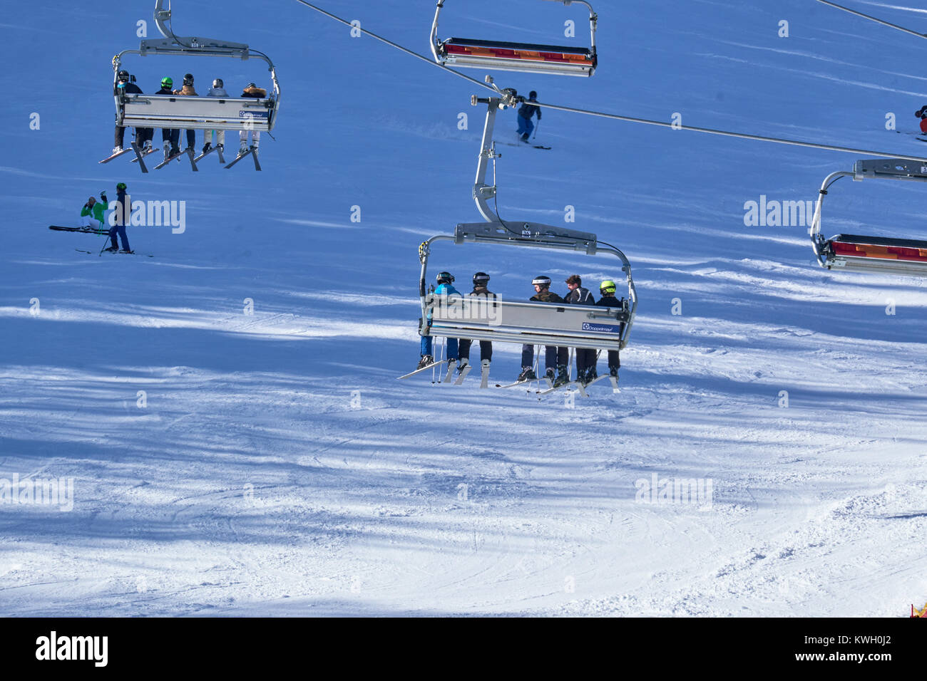 WINTERBERG, GERMANY - FEBRUARY 15, 2017: Going to the top in a relaxing chairlift at Ski Carousel Winterberg - Stock Image