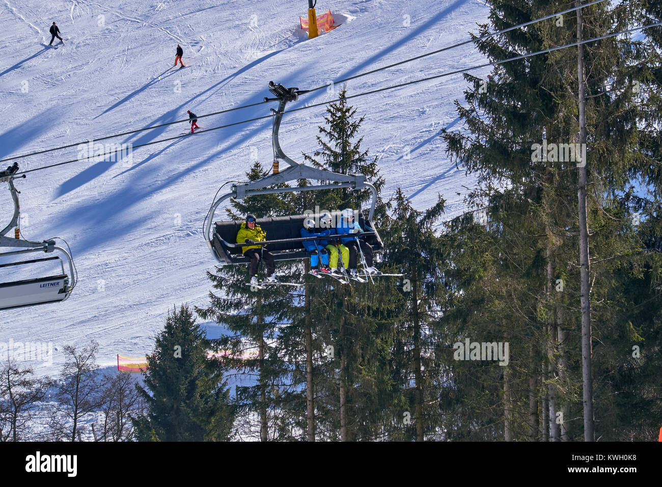 WINTERBERG, GERMANY - FEBRUARY 15, 2017: People sitting in an eight seater chairlift at Ski Carousel Winterberg - Stock Image