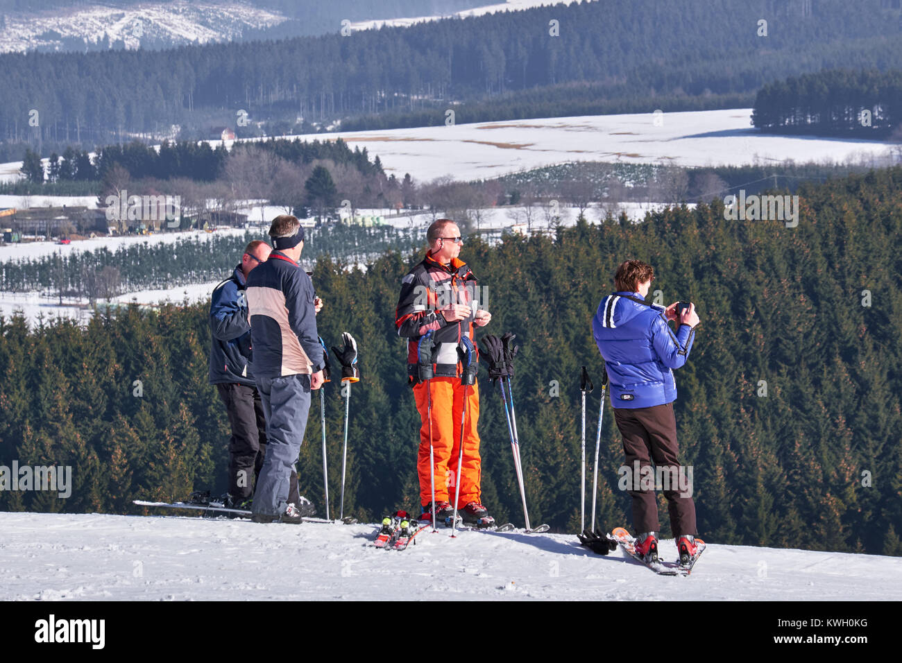 WINTERBERG, GERMANY - FEBRUARY 15, 2017: Group of skiers taking a break on a top at Ski Carousel Winterberg - Stock Image
