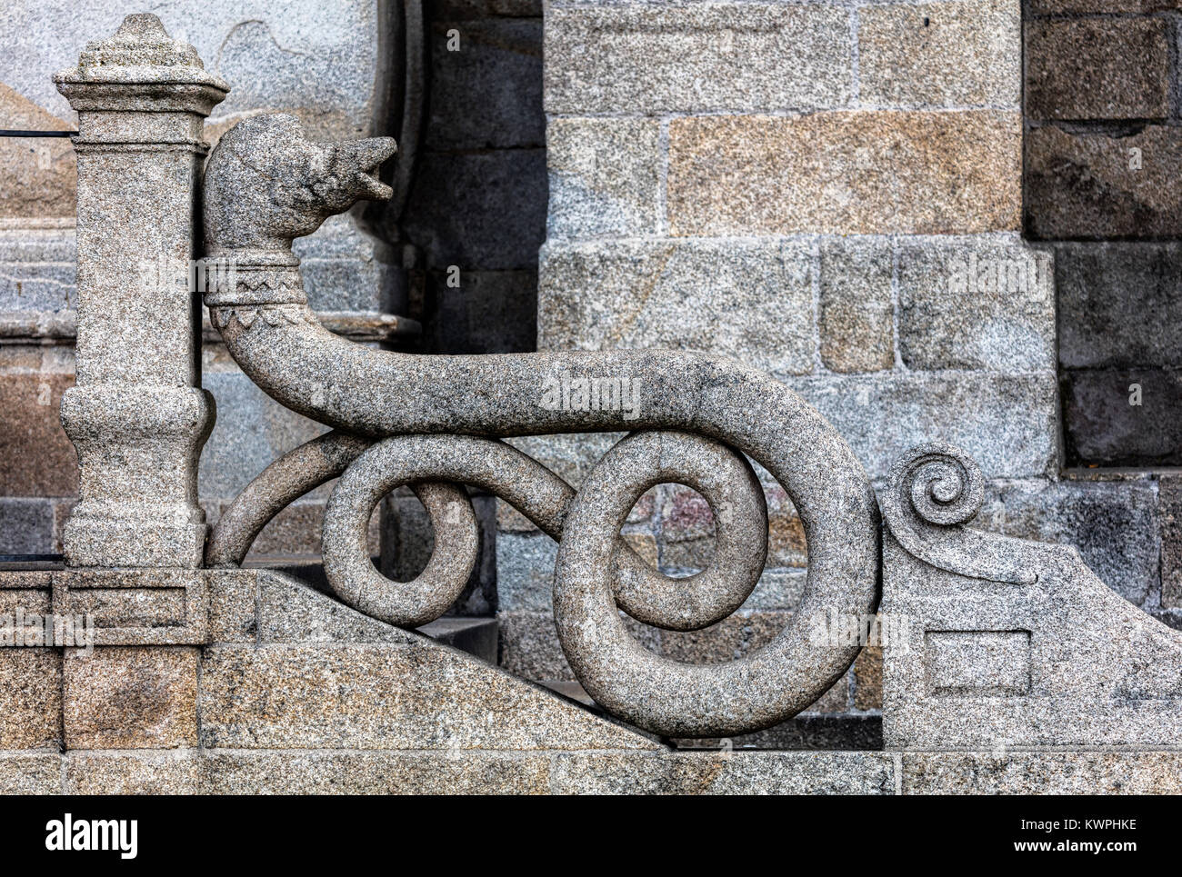 Medieval stone snake balustrade of the Porto cathedral in Porto, Portugal - Stock Image