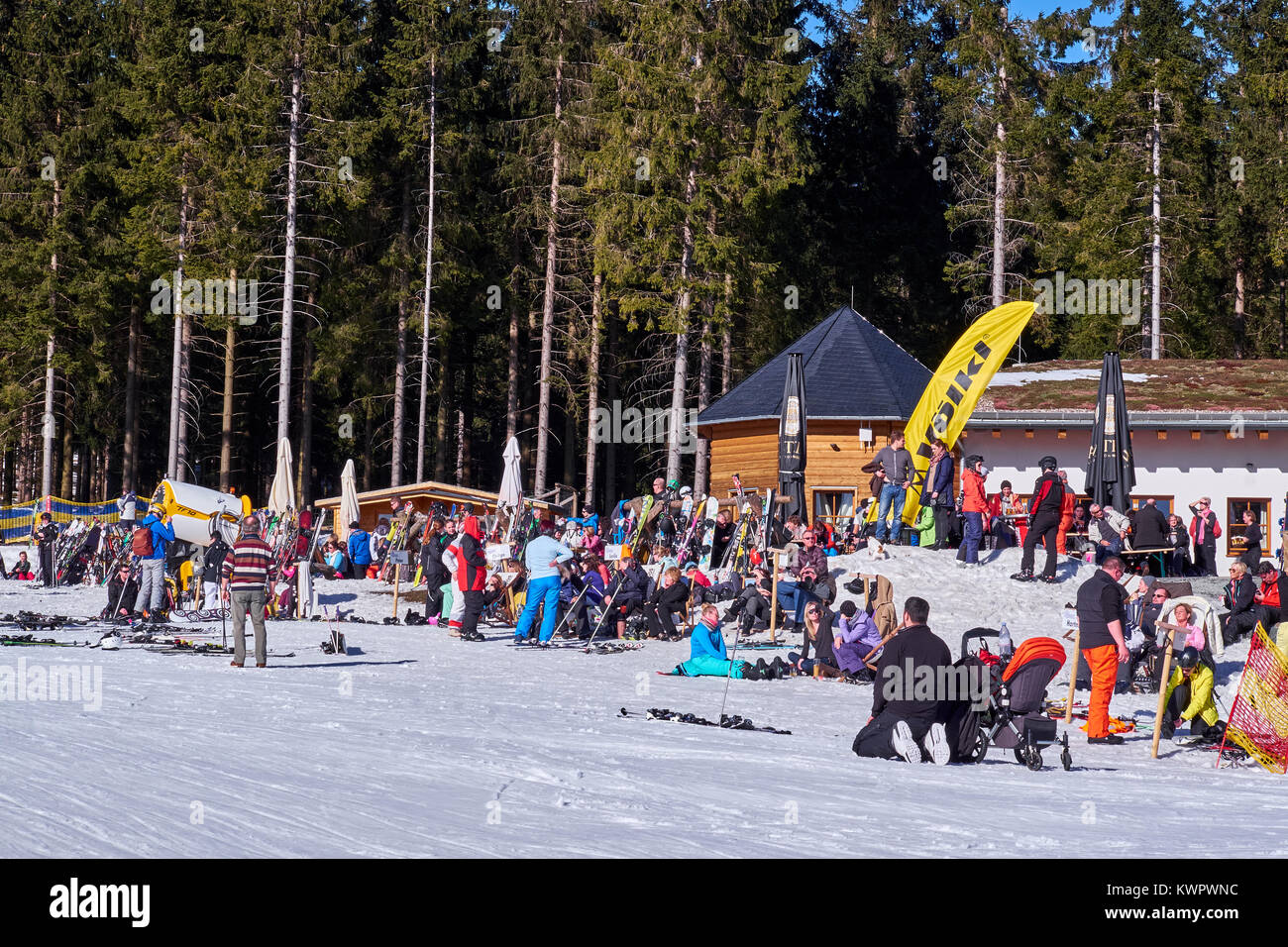 WINTERBERG, GERMANY - FEBRUARY 15, 2017: People chilling out in the sun on a piste at Ski Carousel Winterberg - Stock Image