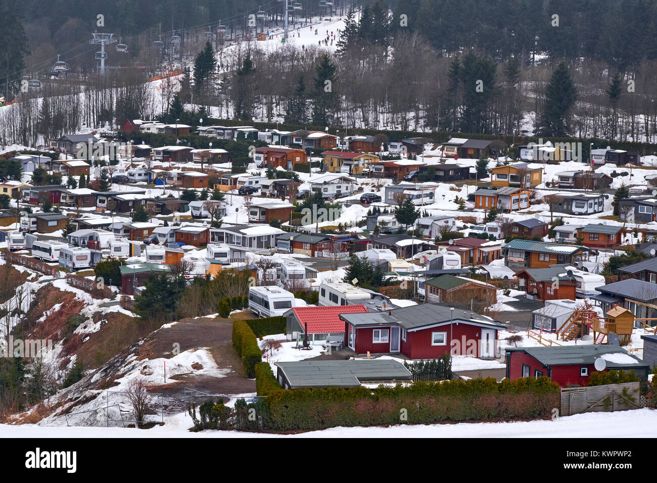 WINTERBERG, GERMANY - FEBRUARY 16, 2017: Camp site with trailers and small wood cabins at Ski Carousel Winterberg - Stock Image