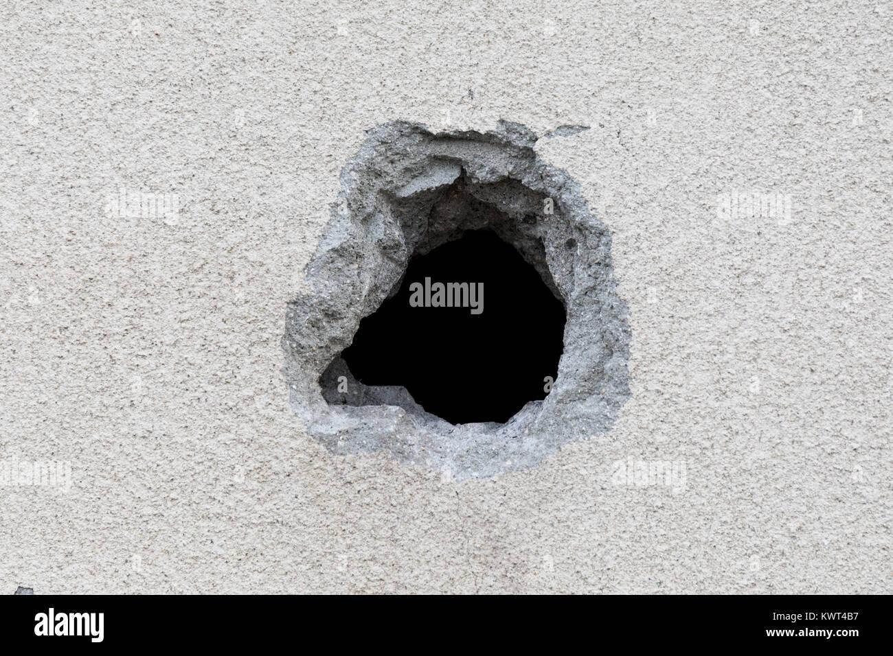Hole in a concrete wall; Fukuyama, Japan Stock Photo