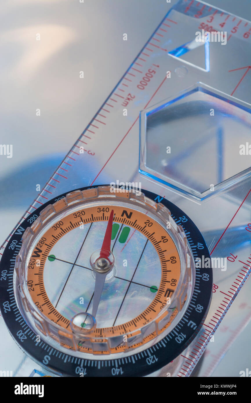 Macro-photo of compass rose face with needle - with copy space. North direction. - Stock Image