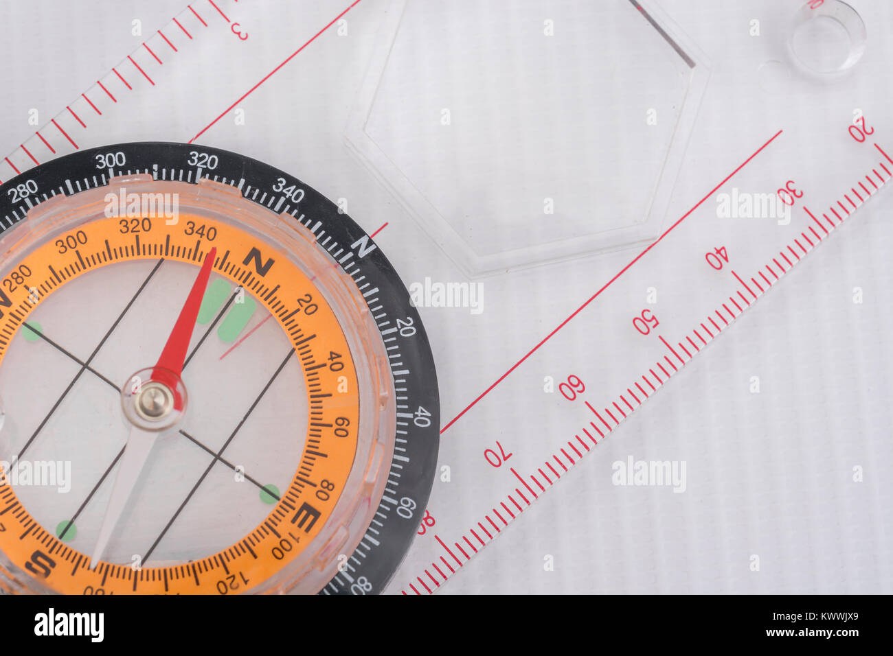 Macro-photo of compass rose face with needle - with copy space North direction. - Stock Image