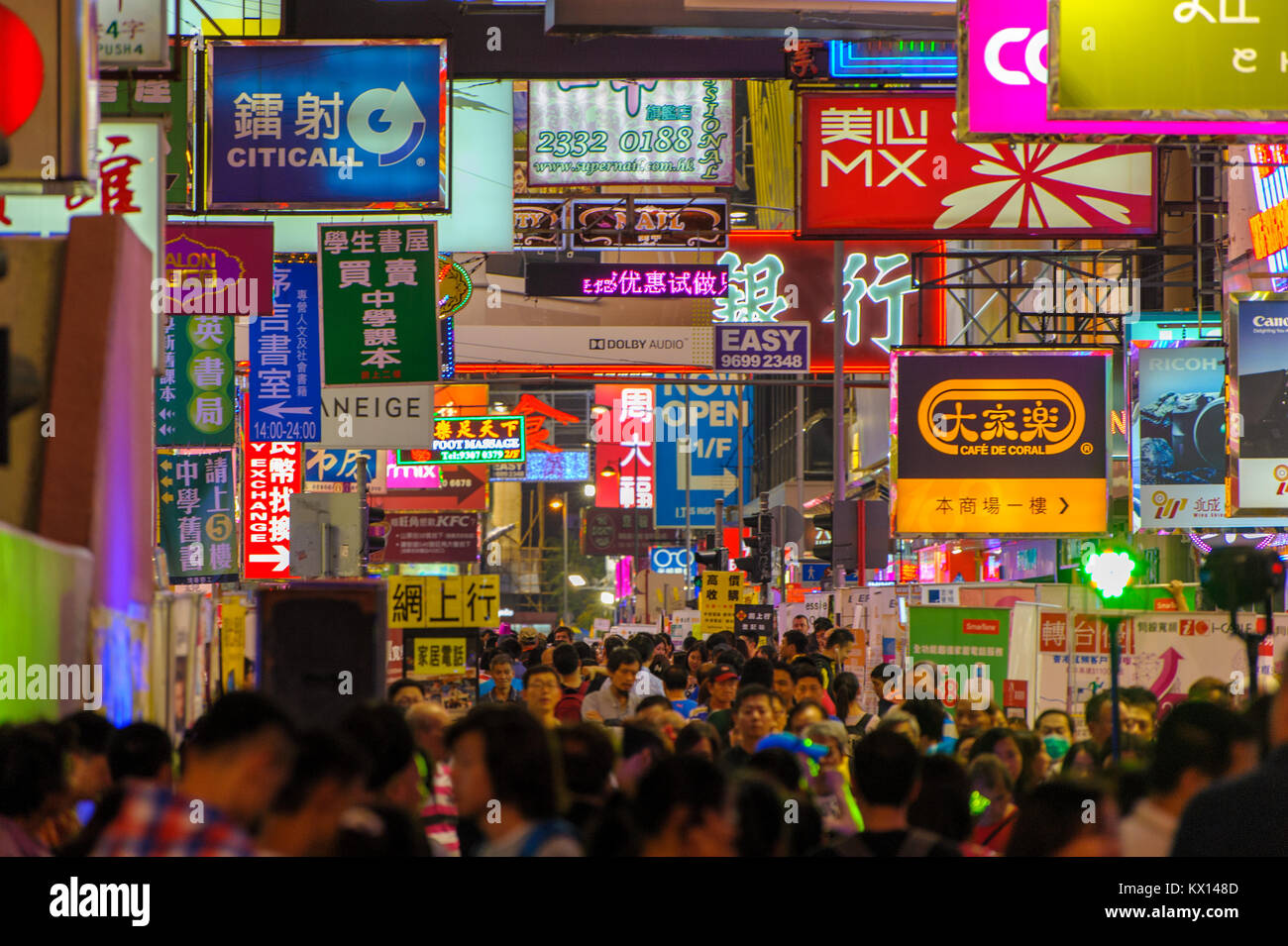 street view of hong kong with many advertising billboards - Stock Image