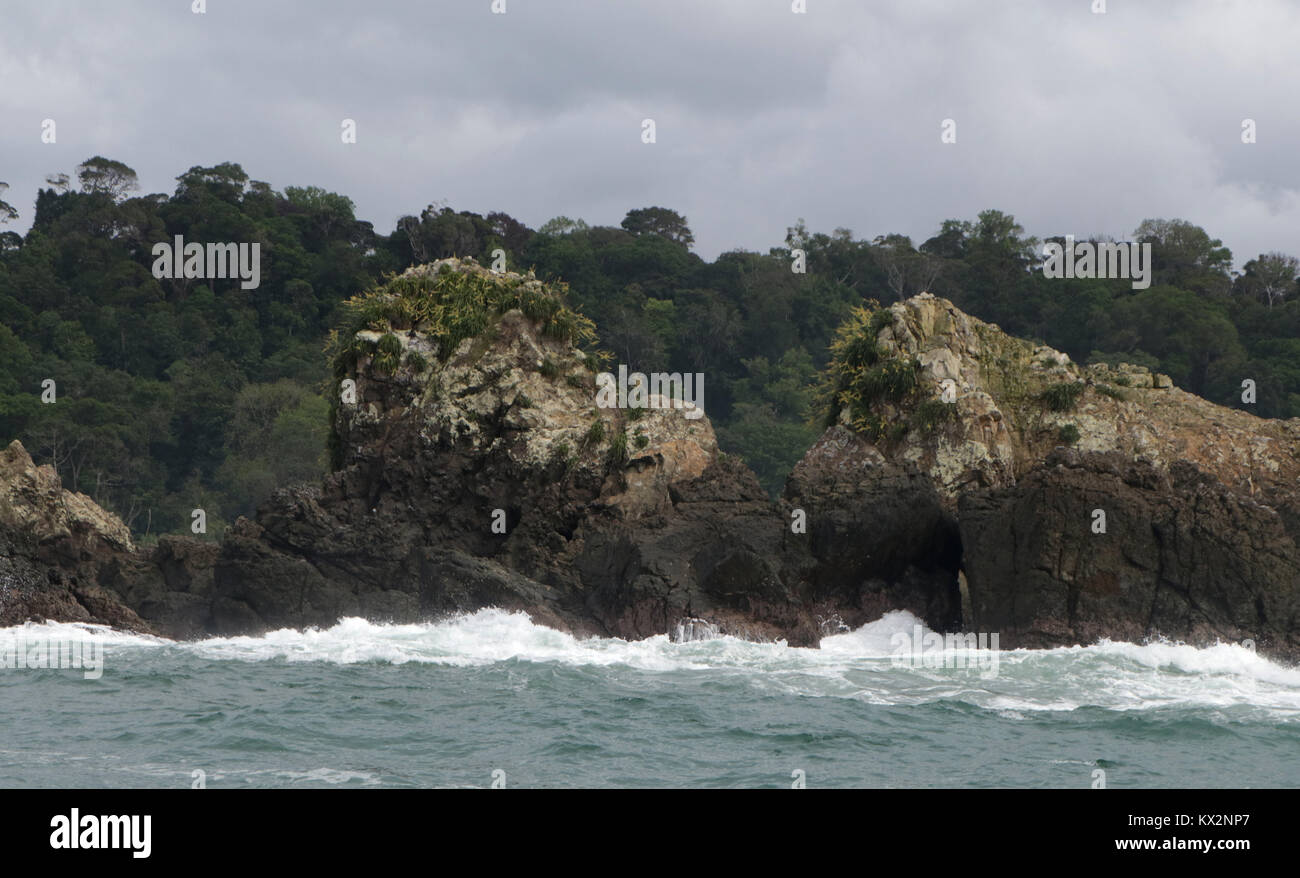 Boat with tourist jumping waves view from ocean Corcovado national Park Osa Peninsula Costa Rica Stock Photo
