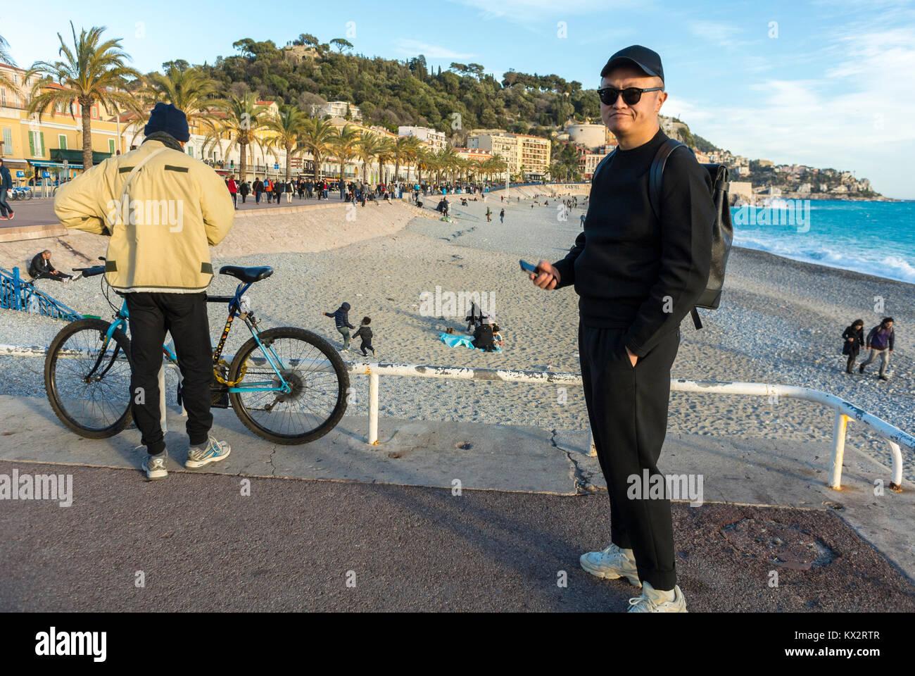 Nice, France, Chinese Tourists visiting Promenade des Anglais, Near Mediterranean Sea Beach - Stock Image
