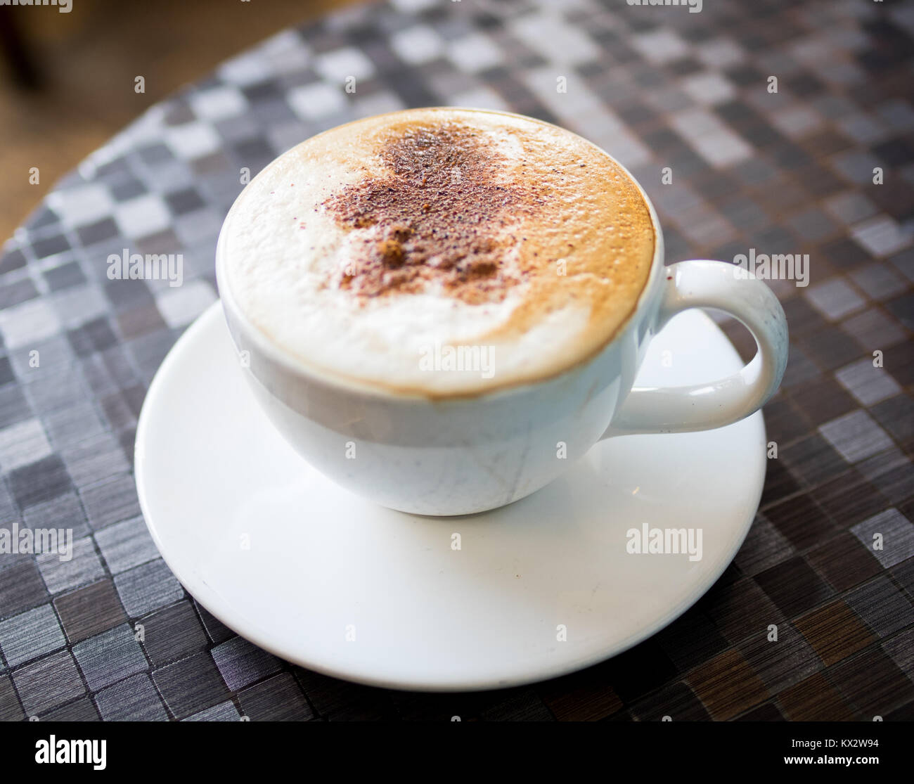 A gingerbread latte from d'Lish by Tish Cafe in Saskatoon, Saskatchewan, Canada. - Stock Image
