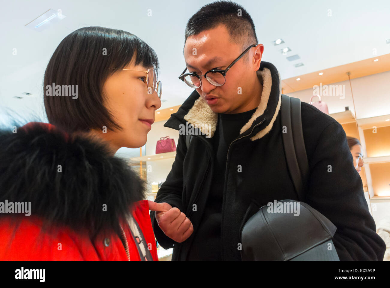Nice, France, Chinese Tourists, Shopping, Talking, Louis Vuitton LVMH luxury CLothing Store - Stock Image