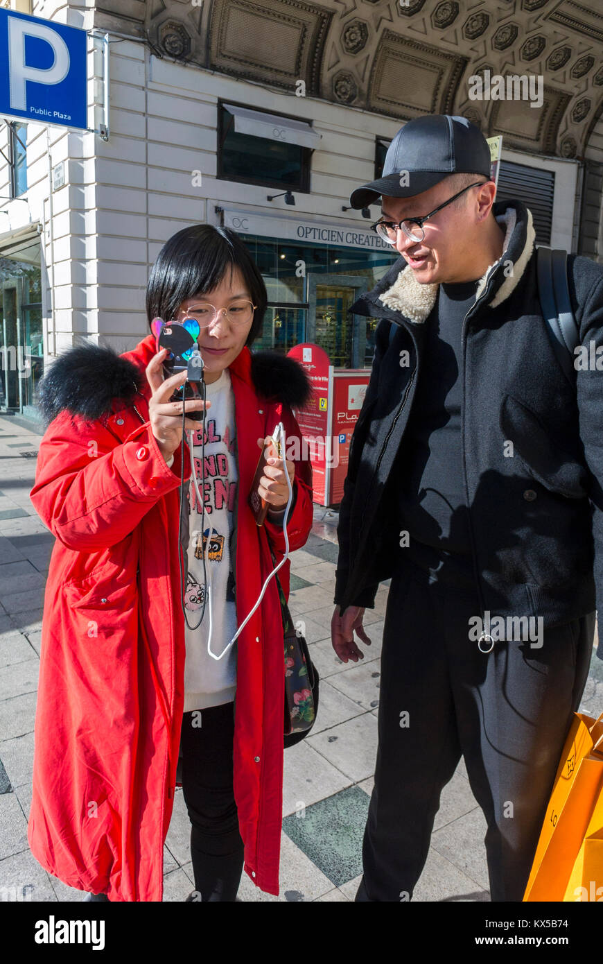 Nice, France, Chinese Tourists Shopping, Couple Talking on Street, Town Center - Stock Image