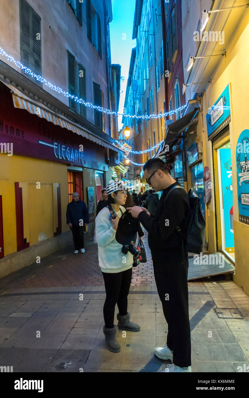 Nice, France, Chinese Tourists visiting Old Town city Center at Night - Stock Image