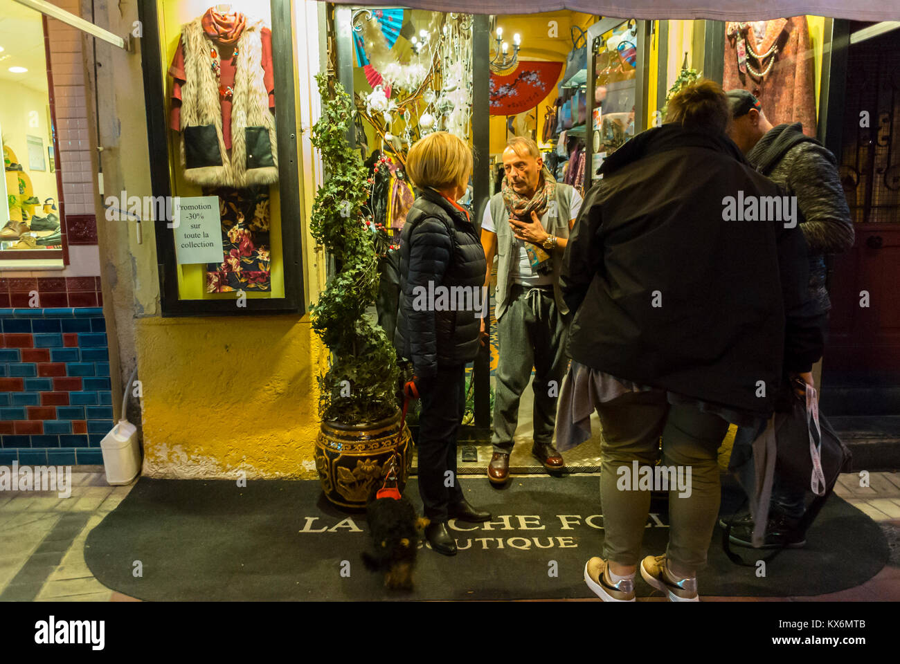 Nice, France, Local Clothing Store, Open at Night in Old Town, Store Front - Stock Image