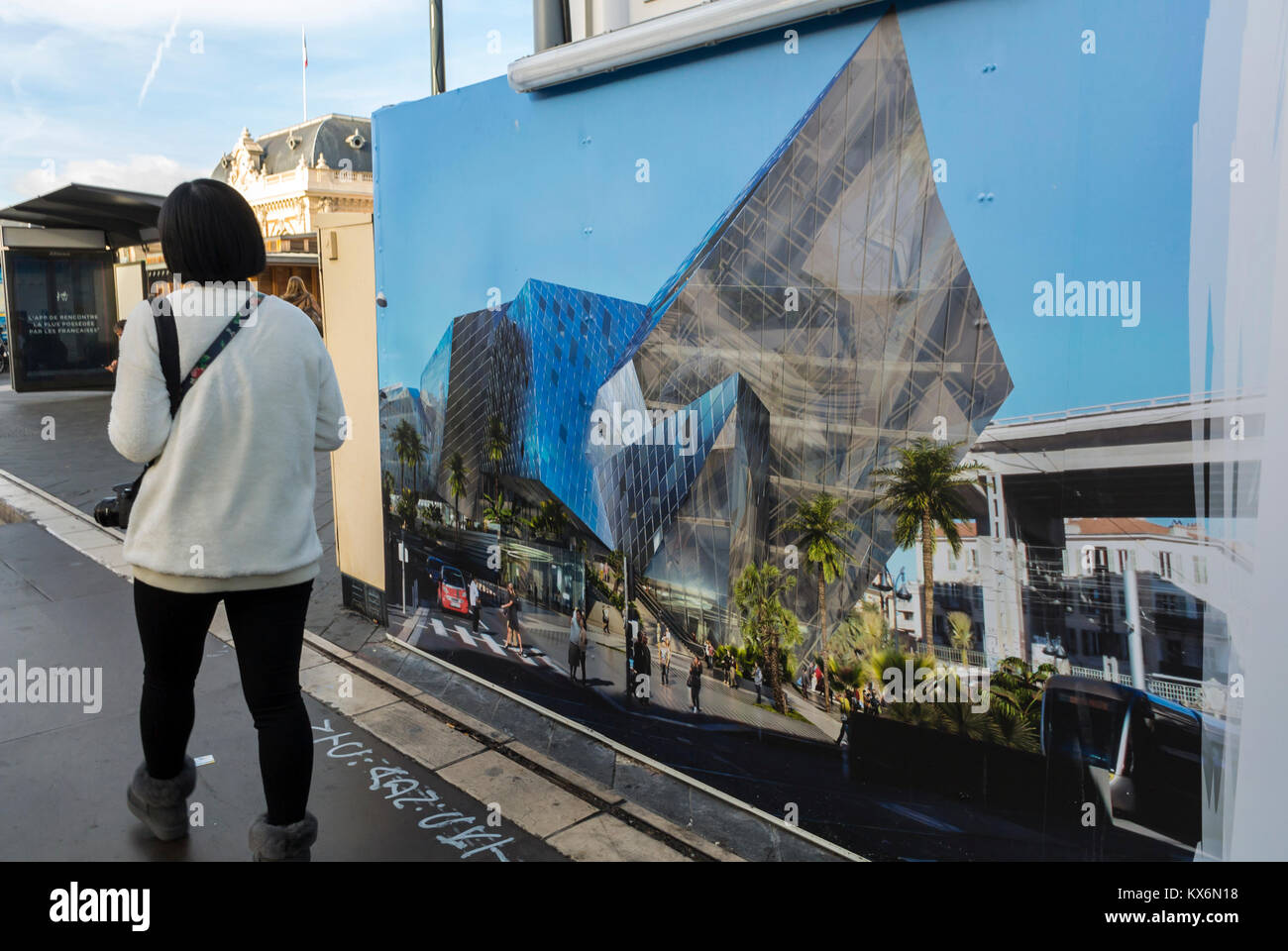 Nice, France, Woman Walking Away, New Building Construction Poster on Street near Train Station - Stock Image