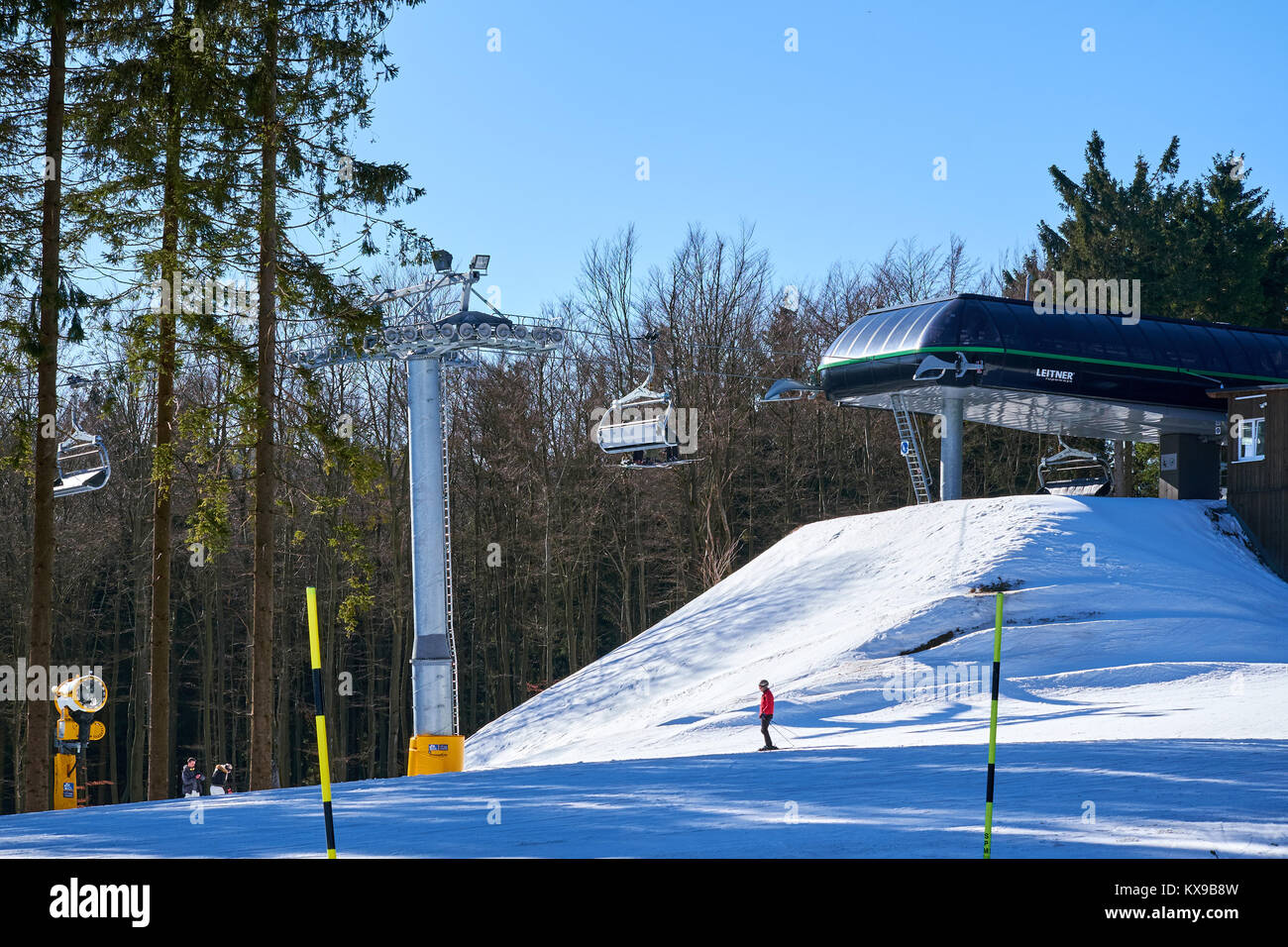 WINTERBERG, GERMANY - FEBRUARY 15, 2017: Chairlift just about to land at a mountain top at Ski Carousel Winterberg - Stock Image