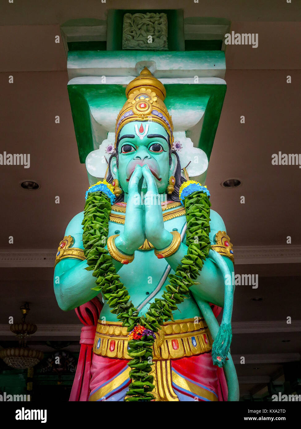 One of many statues to Hanuman, a popular Hinduism deity, that stand in the popular tourist attraction , Batu Caves - Stock Image