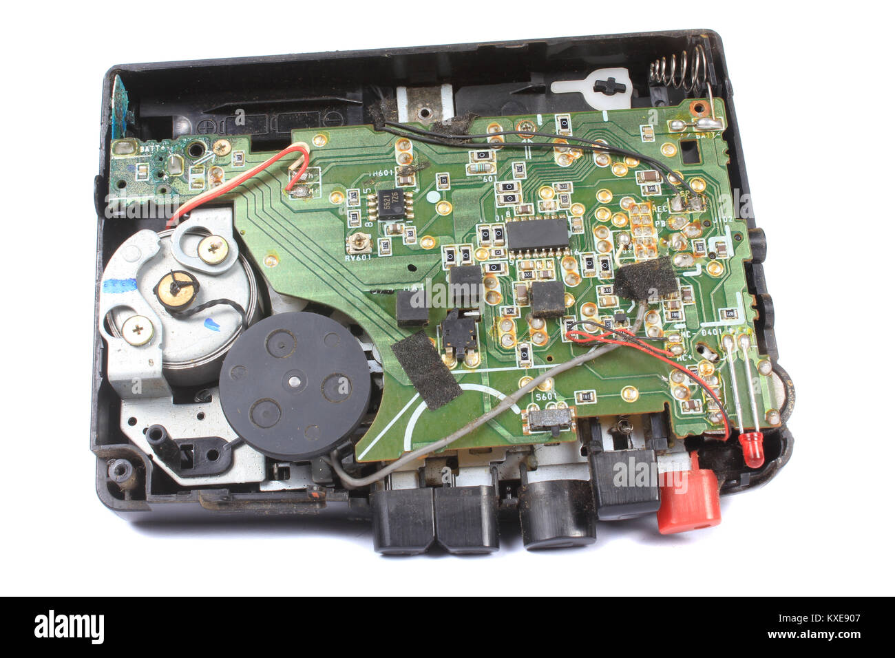 An old audio cassette walkman stripped down to show its circuitry and retro technology. - Stock Image