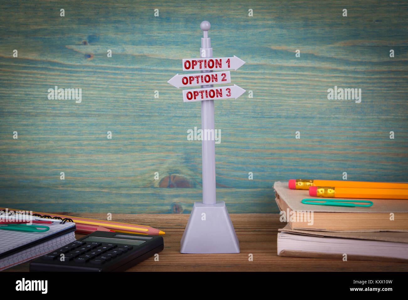 option 1, option 2, option 3. Signpost on wooden table - Stock Image