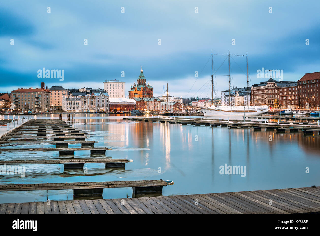 Helsinki, Finland - December 6, 2016: View Of Evening City And Uspenski Cathedral From Pier. Stock Photo