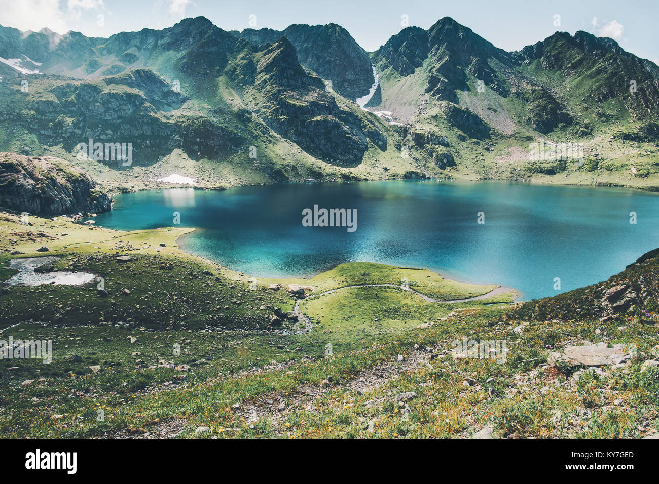 Turquoise Lake and Mountains range Landscape Summer Travel serene aerial view - Stock Image