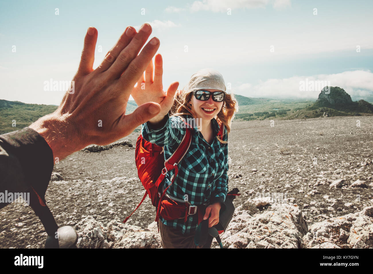 Happy Friends giving five hands traveling at mountains Travel Lifestyle positive emotions concept. Young couple - Stock Image