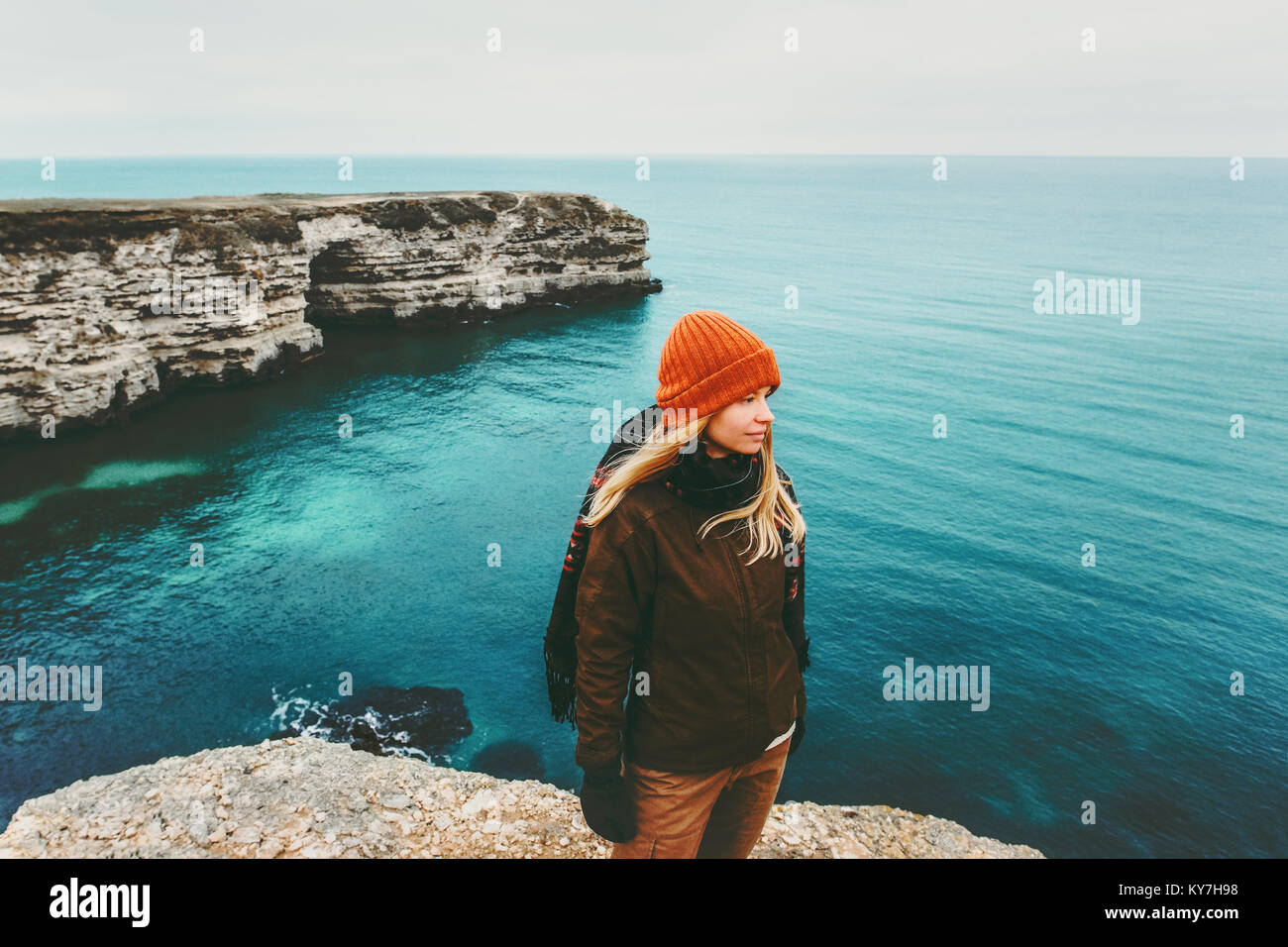 Woman traveler walking above sea Travel Lifestyle concept adventure active vacations outdoor harmony with nature - Stock Image