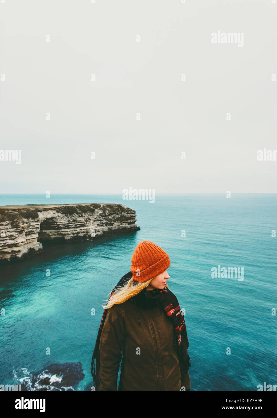 Woman walking at cold sea view alone Travel Lifestyle concept adventure vacations outdoor - Stock Image