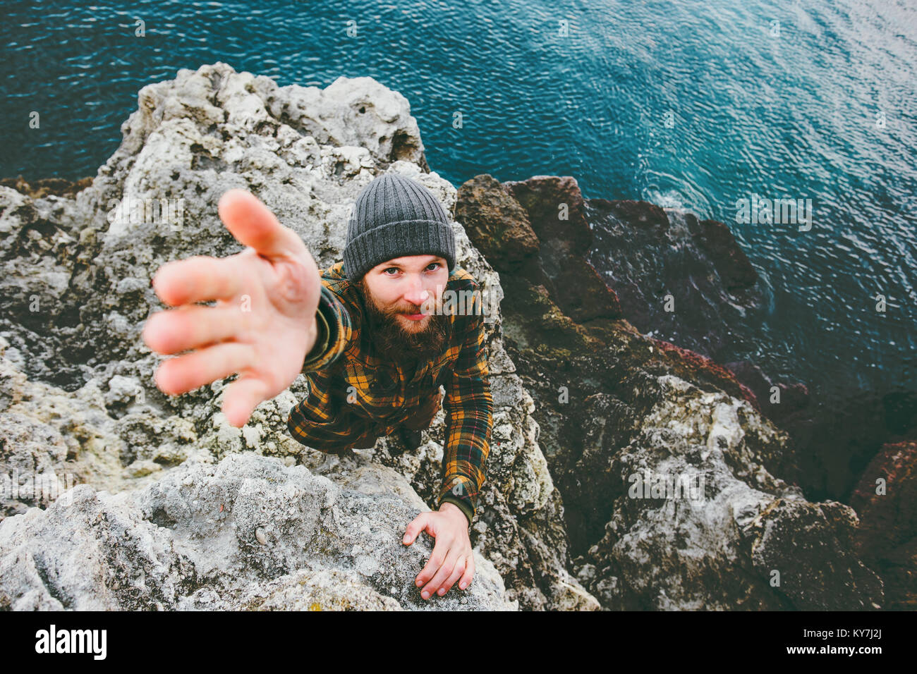 Man help giving hand Travel Lifestyle concept vacations at sea outdoor - Stock Image