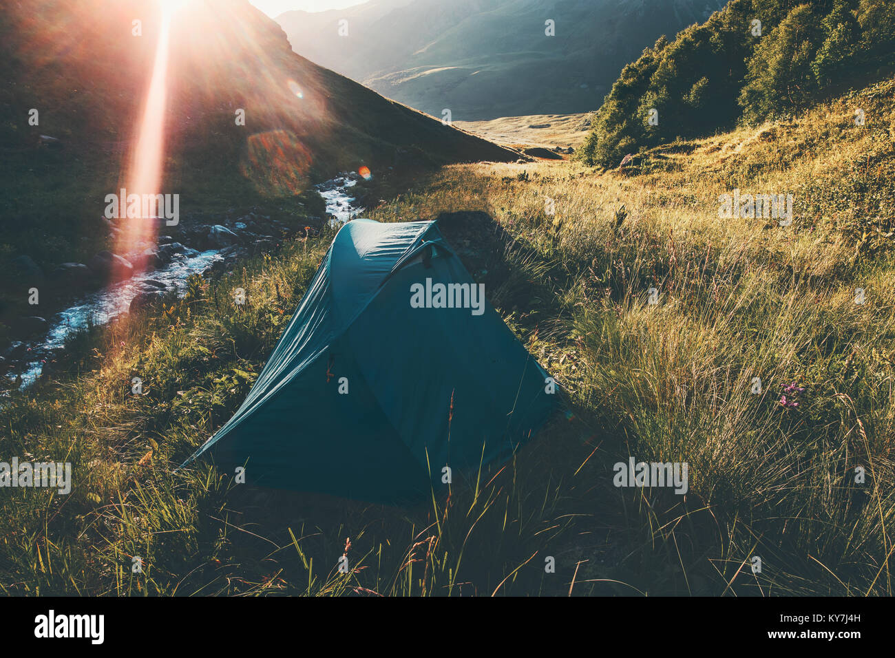 Tent camping at Mountains Landscape Travel Lifestyle concept Summer adventure vacations outdoor - Stock Image