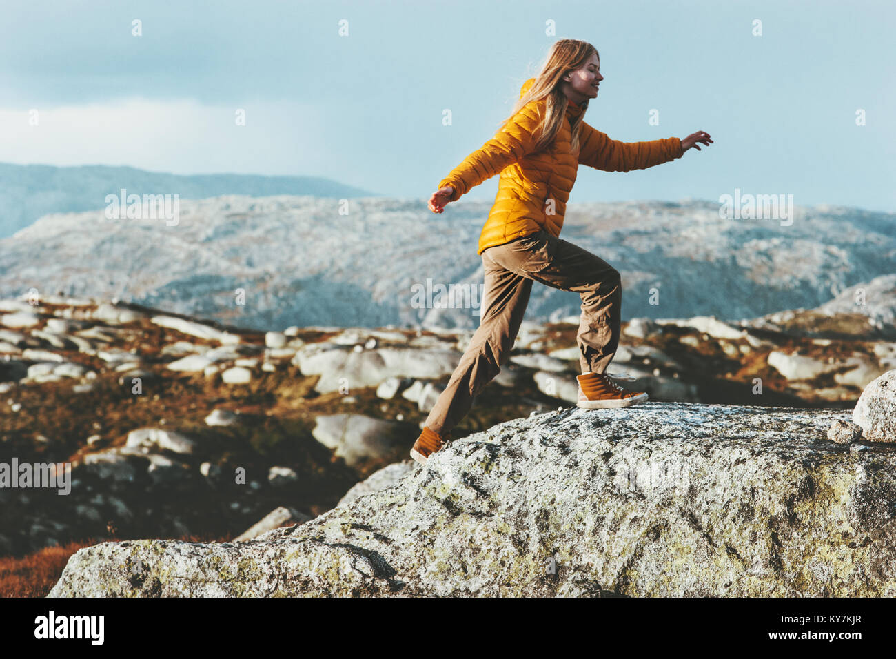 Happy Woman running outdoor in mountains Travel healthy Lifestyle concept adventure positive emotions and motivation - Stock Image