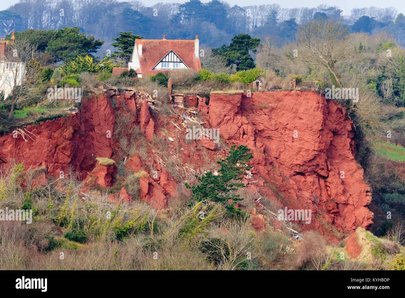 Red Permian breccia rockfall on the cliffs at Oddicombe beach, Babbacombe,Torquay, Devon. Wreckage from a destroyed Stock Photo
