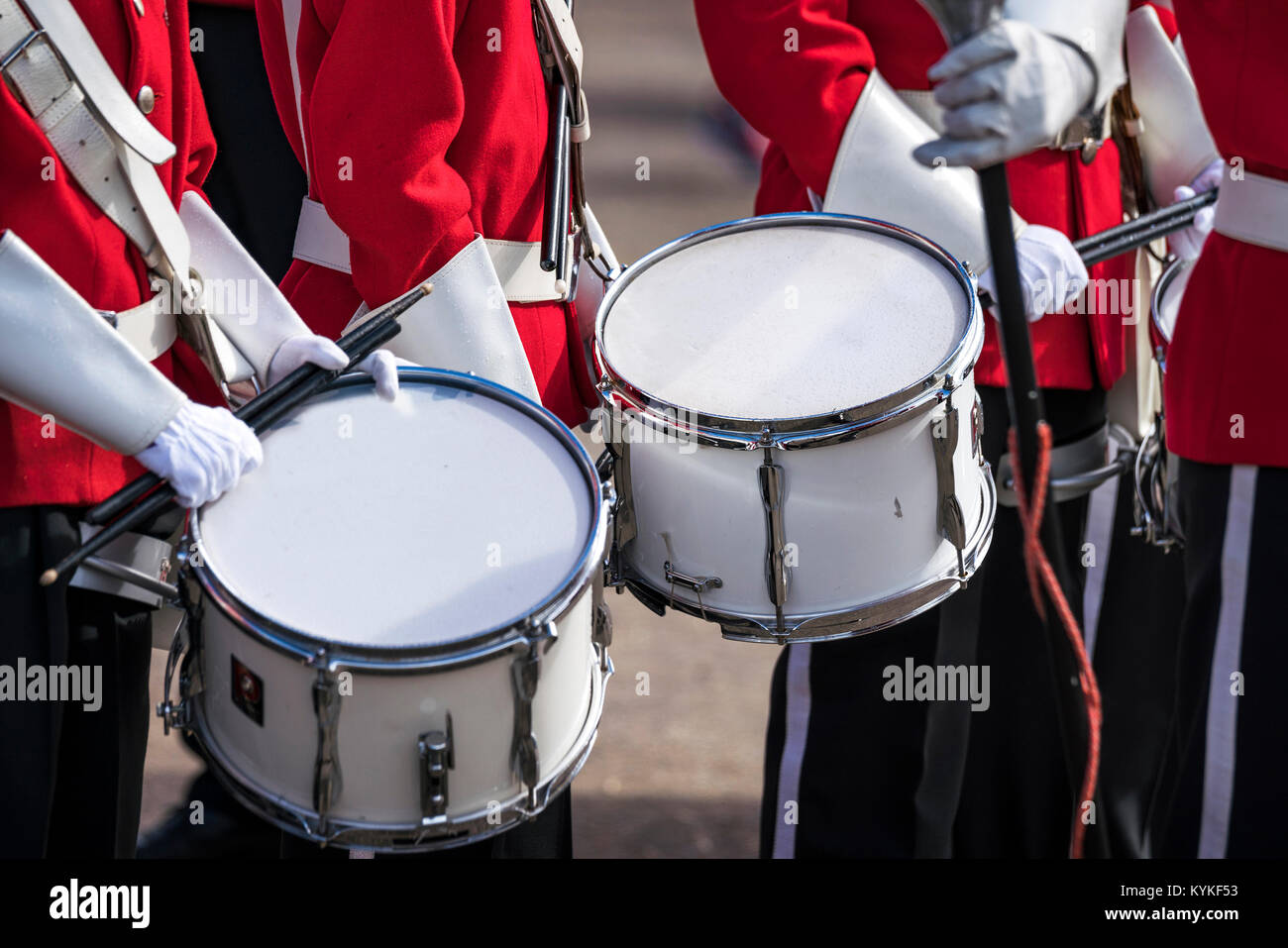 Soldiers in red uniforms with drums at a parade in the spring - Stock Image