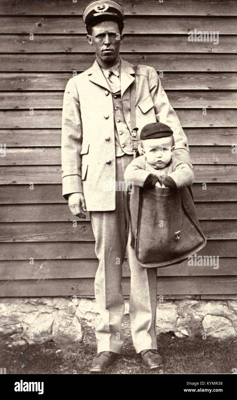 Uniformed Letter Carrier with Child in Mailbag 2584174182 o - Stock Image