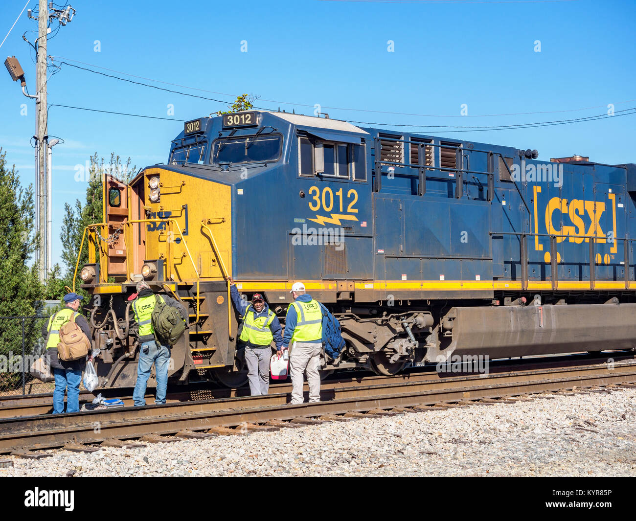 Crew members wait to board CSX Transportation diesel locomotive #3012 an evolution series GE ES44AH in Montgomery Stock Photo